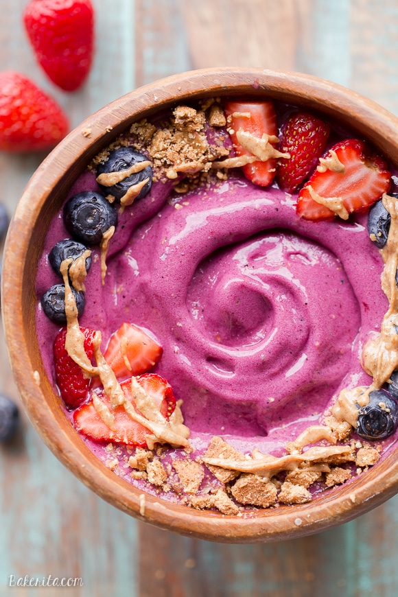 This Berry Pitaya Smoothie Bowl is made from mixed berries, banana, and pitaya - also known as dragonfruit! Top with fresh fruit and other toppings for a nutritious and delicious breakfast or brunch.