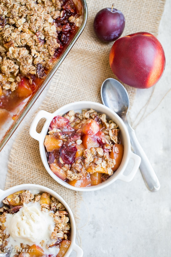 This Summer Stone Fruit Crisp features lightly sweetened peaches, plums, and nectarines topped with a oatmeal pecan crumble topping. This gluten-free and vegan dessert showcases the best of summer!