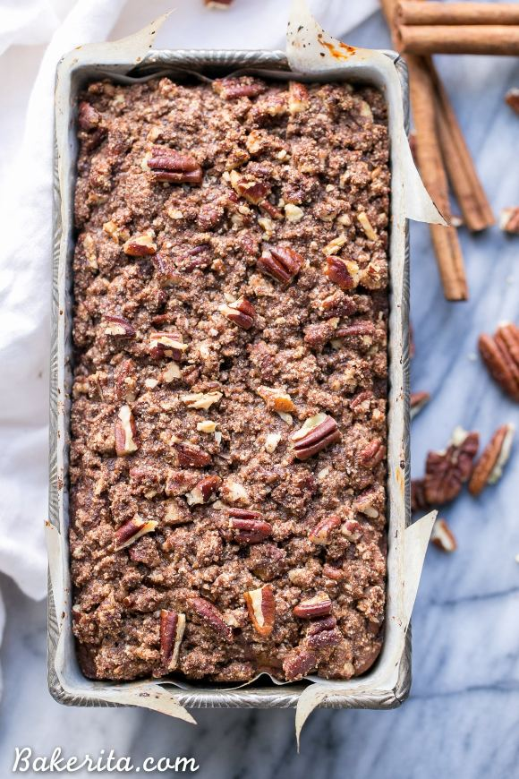 This Paleo Cinnamon Streusel Banana Bread has a layer of pecan crumble in the center and on top, creating a ripple of cinnamon flavor throughout the whole loaf of banana bread. This moist gluten-free + refined sugar free bread is sweetened with bananas and made with coconut flour.