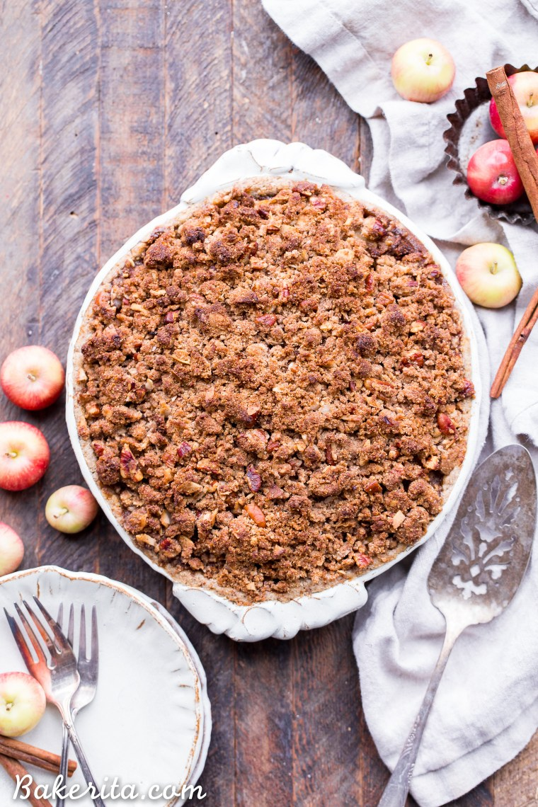 This Apple Crumble Pie is so delicious it's bound to be a holiday dessert staple! This gluten free, paleo + vegan pie is filled with soft, caramelized apples and topped with a nutty, crunchy paleo crumble topping.