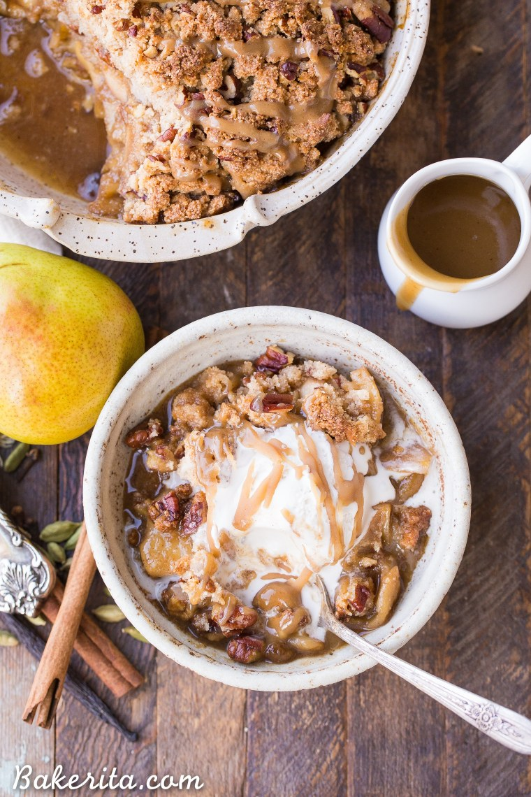 This Caramel Pear Crisp is a decadent and deliciously spiced dessert that's perfect for the holidays. The caramel pear filling is spiced with cinnamon, cardamom, cloves, and vanilla bean, and topped with a crunchy almond flour and pecan crisp topping. Don't forget to serve this gluten-free, paleo, and vegan crisp with some whipped coconut cream!