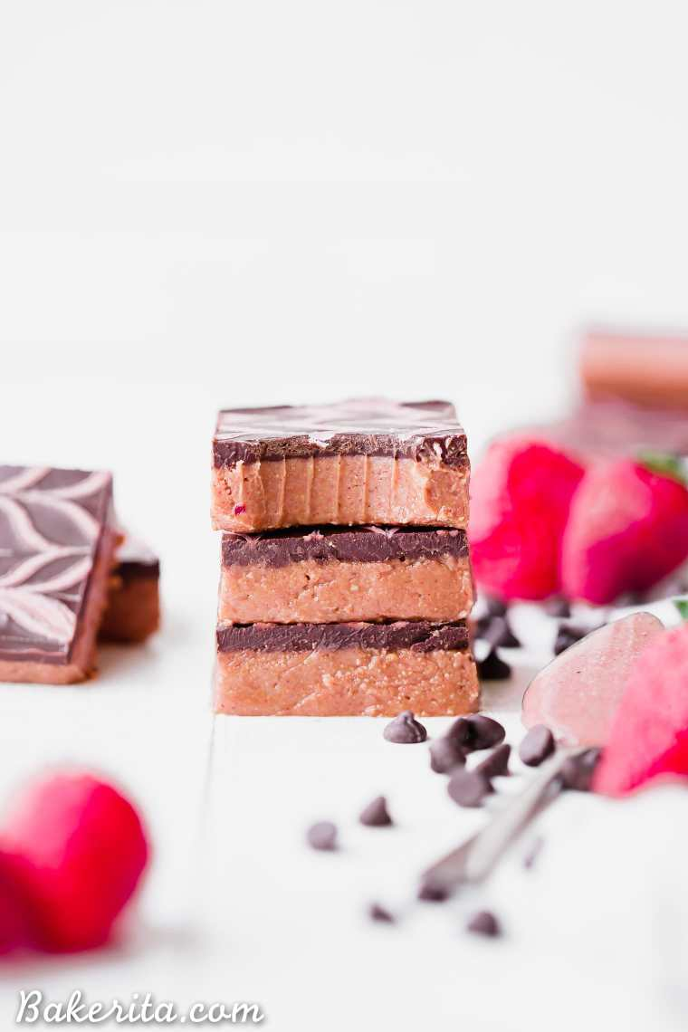 These No Bake Chocolate Strawberry Cashew Butter Bars have a creamy strawberry cashew butter base, topped with dark chocolate and a strawberry drizzle. You only need seven ingredients to make these irresistible gluten-free, paleo and vegan cashew butter bars.