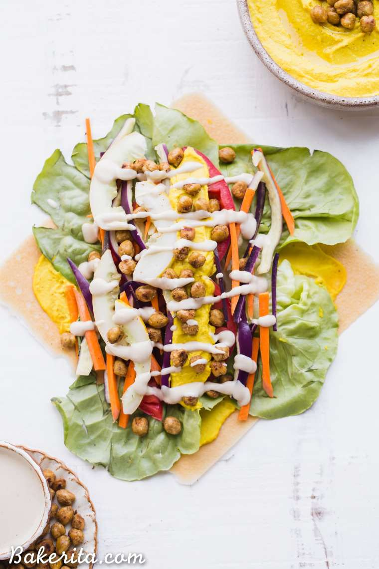 These Roasted ChickpeaVeggie Wraps are a delicious gluten-free and vegan lunch or dinner that you can make ahead of time. They have a wonderful Turmeric Hummus spread inside and a Tahini Dressing/Dipping Sauce to serve with!