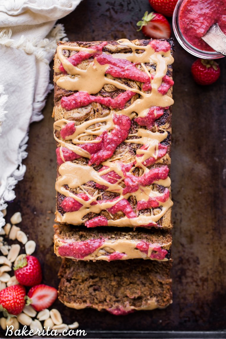 This Peanut Butter & Jelly Banana Bread will remind you of a PB&J sandwich, but in soft & sweet banana bread form. This recipe is gluten-free, vegan, and layered with homemade strawberry chia jam and creamy peanut butter.