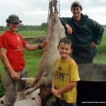 The heroes: Joe, Sam, and Keith butchering a hog.
