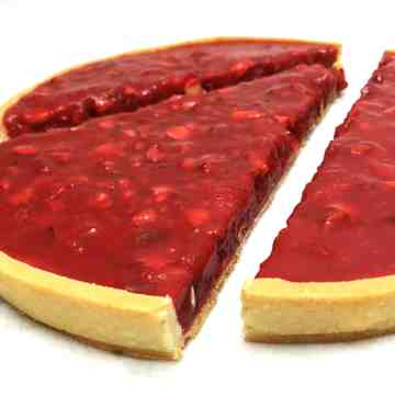 Pink Praline Tart is one of the best party desserts. This unique tart created in Lyon (France) can easily feed a crowd: a regular-sized tart serves 12 people. Pink praline crushed and cooked with the heavy cream is the main ingredient of the tart filling. It gives a gorgeous presentation and red color to the tart that makes it one of the best Valentine's desserts as well. Bring France to the table! #pinkpraline #valentines #party #partyideas #tart #dessertsforacrowd| www.bakinglikeachef.com