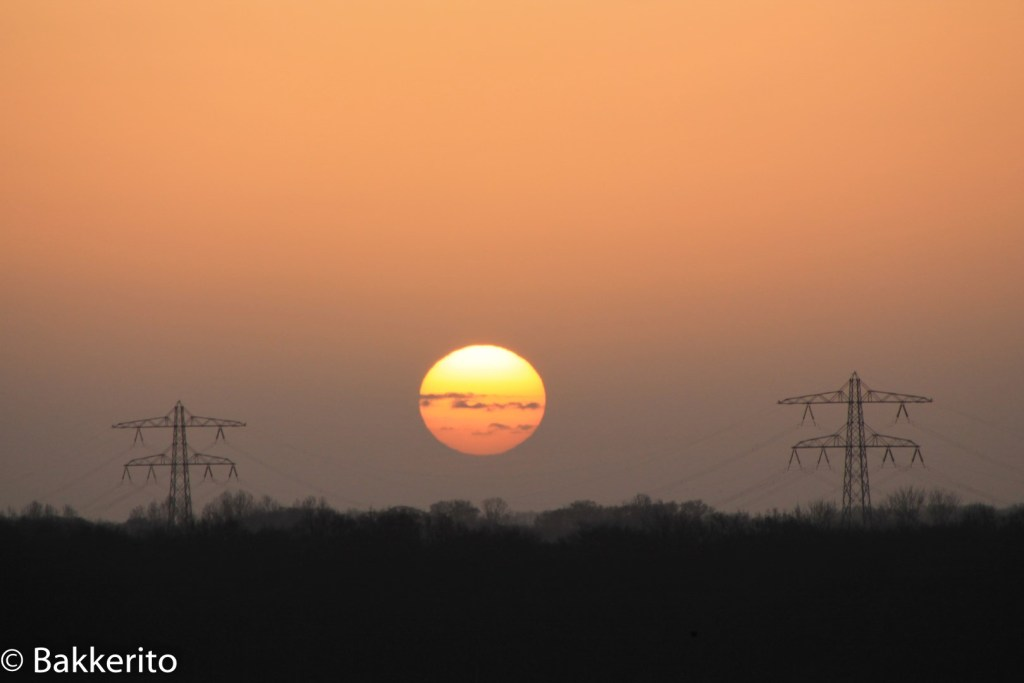 Sunrise over energy lines