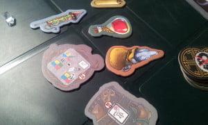 Potenti artefatti possono essere vinti dai monaci salvando gli abitanti del villaggio (richiesta l'espansione White Moon)