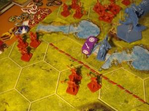 Gli arcieri colpiscono col risultato contrassegnato dai cerchi concentrici: i resti dei cavalleggeri sul guado saranno presto trascinati via dalla corrente.