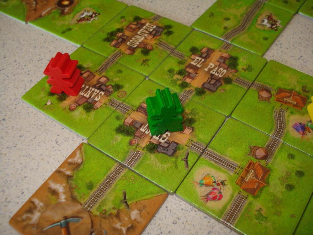 La città permette di guadagnare tre punti per ogni ferrovia finita: 12 punti per il verde, e il meeple torna in mano al giocatore!