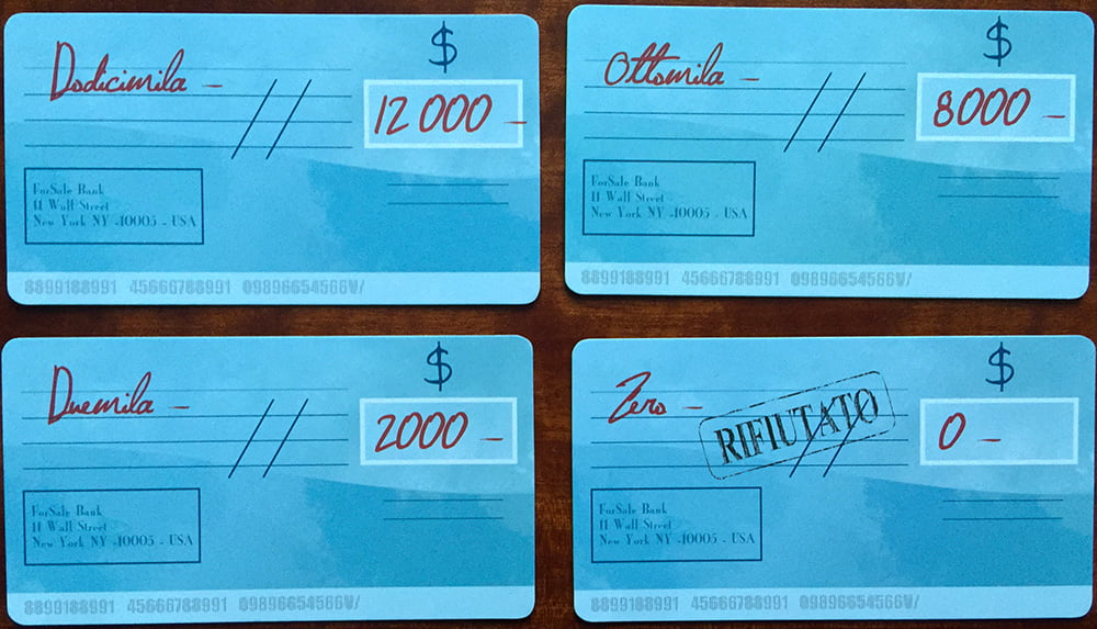 Questa, invece, è una mano di assegni, sempre in una partita a 4. Attenzione all'assegno rifiutato, che vale 0, in basso a destra: