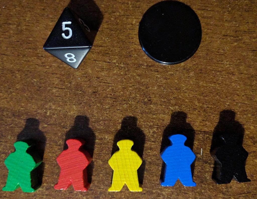 In basso, i meeple che rappresentano i mercanti della partita. In alto, invece, il dado e il gettone-segnalino del primo giocatore.