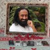 Sri Sri Ravi Shankar suggests charging Mobile Phones in front of his Picture - 18 Feb 13