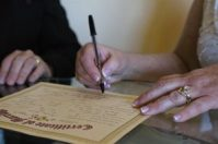 couple signing legal marriage-certificate