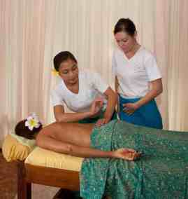 Bali BISA trainer demonstrating elbow pressure for Massage techniques used in VTCT complementary therapies course