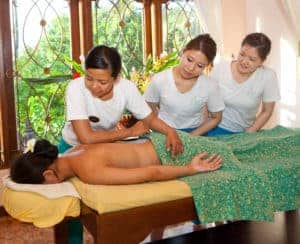Trainer with her students was practicing lomi lomi massage to client