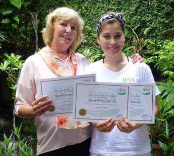 CIBTAC Endorsed Certification graduate with her certificate standing next to Penny Ellis, President of the Bali International Spa Academy in Sanur Bali