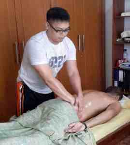 Male Spa Therapist - William practicing sports massage