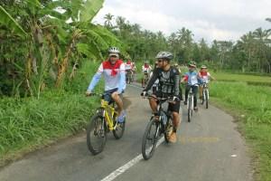 warisan, warisan group, bali cycling, treasure hunt rafting, rafting, cycling, team building, garden team building, fun games, games, Rice paddy cycling, bali rice paddy cycling
