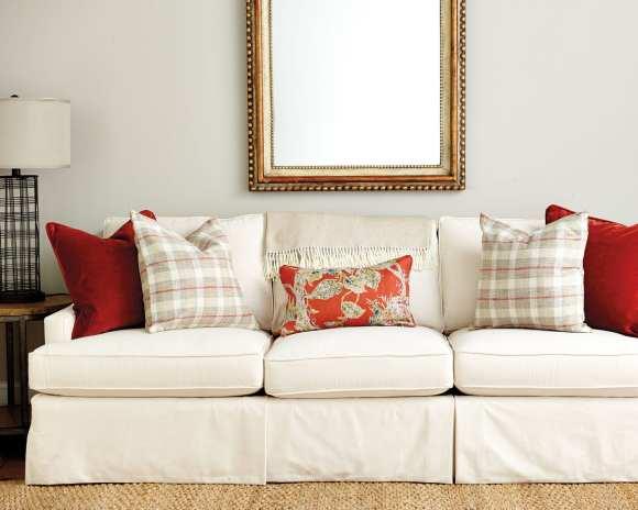 Spicy orange throw pillows on a sofa