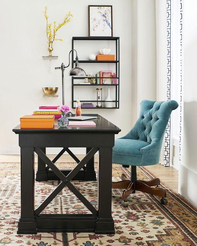 Teal velvet desk chair in bright home office