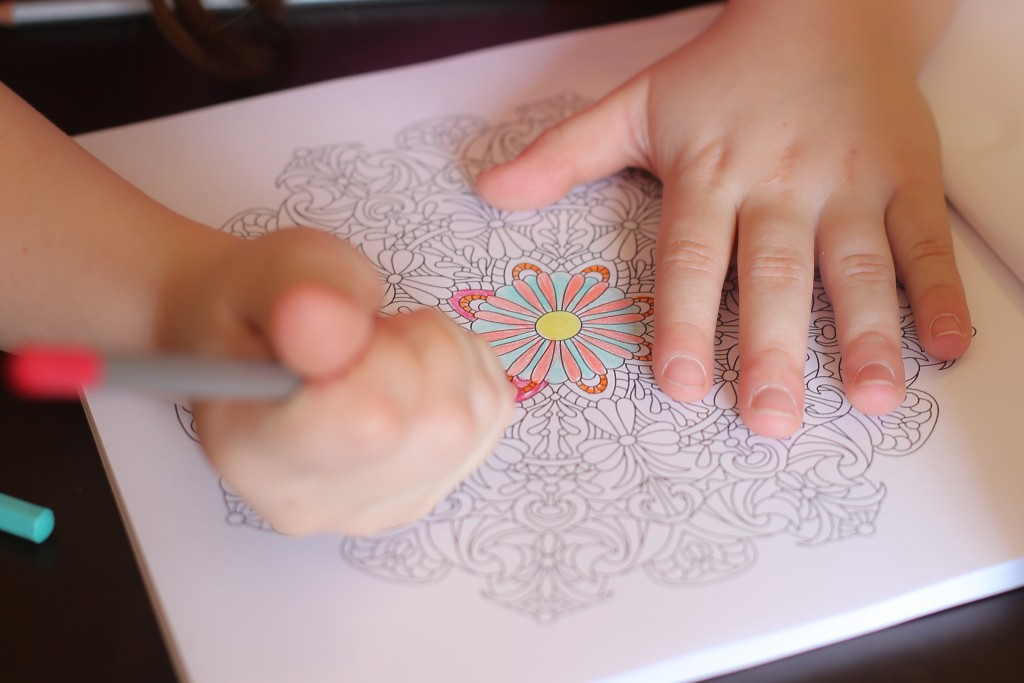 I'm amazed at how well her tiny little hands can handle the intricate designs in these books!