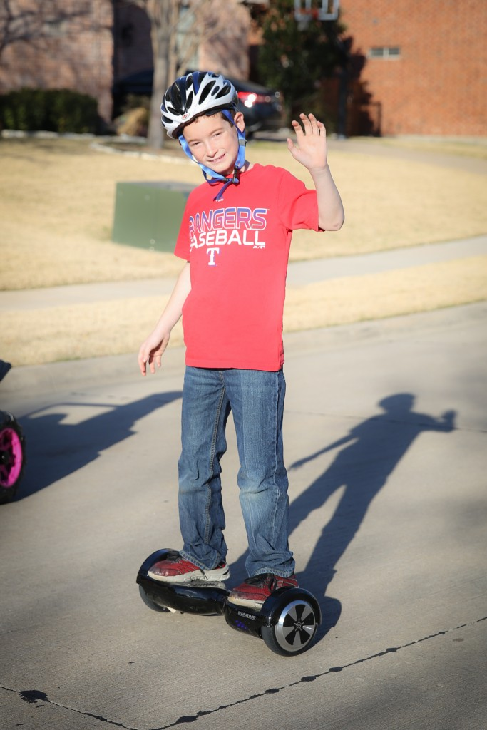 Here's my boy - - cruisin' up and down the street on his hoverboard!