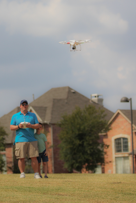 Whenever Mark is out flying his drone, Zach is always close by. Patiently waiting for his turn to fly it!