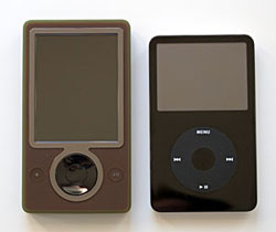 A Zune side by side with a 30GB iPod