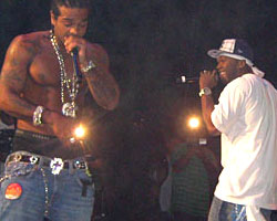 Jim Jones on stage with 50 Cent at Thursday's show (Photo: MTV)