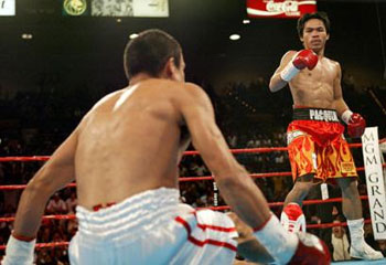 Pacquiao knocking down Marquez during their first bout in May 2004