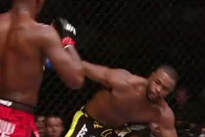 Jon Jones catches Rashad Evans with a vicious elbow at UFC 145