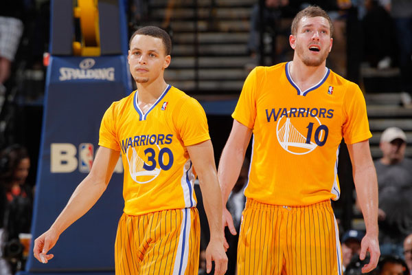 80407c636 Golden State Warriors wearing adidas short-sleeve jerseys.