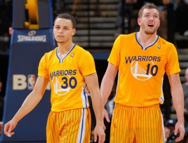 Golden State Warriors wearing adidas short-sleeve jerseys.