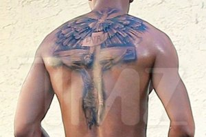 Nick Cannon covers 'Mariah' tattoo.