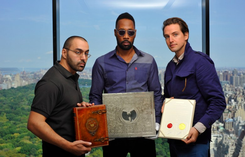 Cilvaringz, RZA, and Gilkes hold the book, box, and certification that come with the album.
