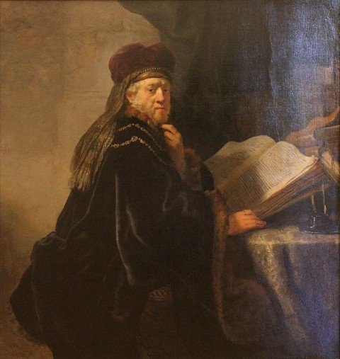Rembrandt_-_A_Scholar_Seated_at_a_Desk