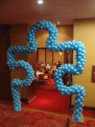 Puzzle piece walk through balloon arch
