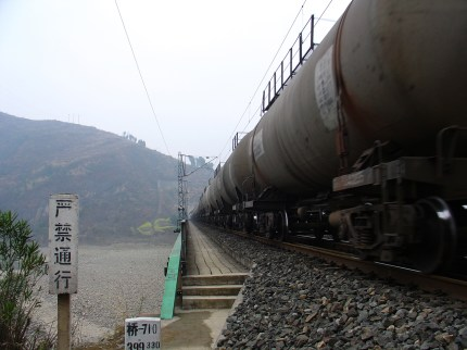 The chinese industry: Next to school lies a railway, where about every ten minutes a train passes by, even at the weekend