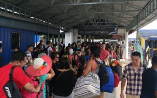Queue to board ferry , Mersing