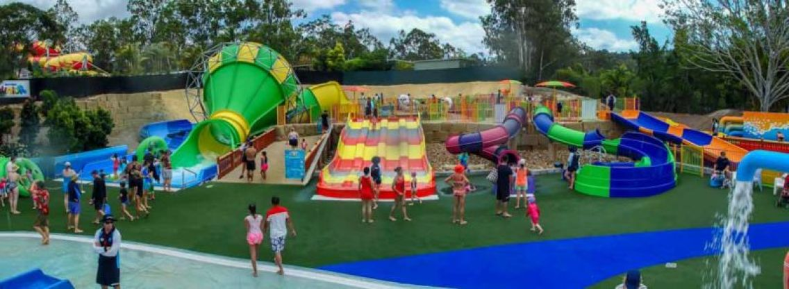 """Miniature water slides that mimics the larger versions thrill slides in other """"grown-up"""" parts of the park"""