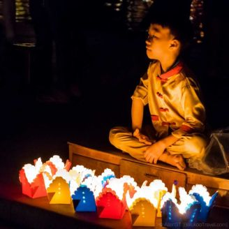 A child selling floating lanterns. Hoi An Ancient Town. (Da Nang, Vietnam)