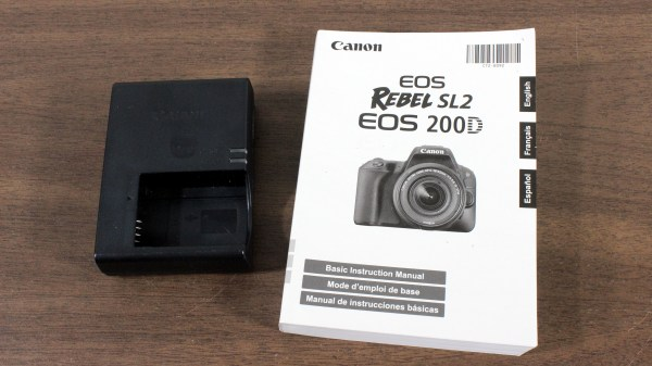 Canon EOS Rebel SL2 / EOS 200D DSLR Camera Manual and battery charger