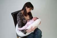 dream genii support pillow woman holding baby in feeding mode