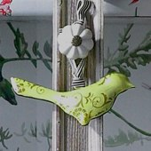 Set of three vintage-style tin hanging birds