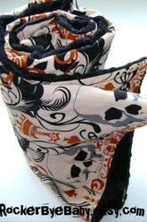 Skull and Crossbones Alexander Henry Regent Skulls Rust color baby or toddler blanket with black minky dot