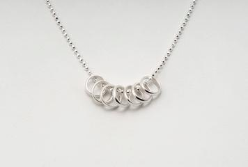 Silver Lucky Seven Rings Necklace by Tales From the Earth