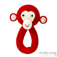 Red crochet monkey rattle by Anne-Claire Petit at Molly-Meg