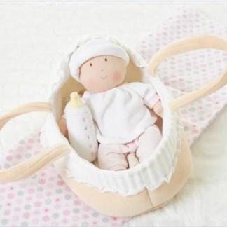bonikka Grace doll in cradle