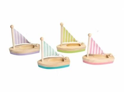 4 small wooden sail boats
